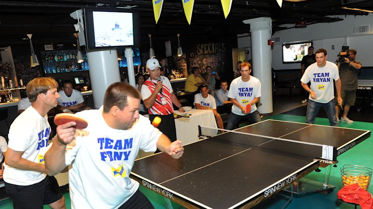 COMMERCIAL IMAGE - Gold medalists and champion tennis players Bob, far right, and Mike Bryan face off against Captain Tom Spade, left, of Brooklyn's Engine Company 242, and Firefighter Glenn Brown, of Manhattan's Engine Company 1, at the Nesquik FDNY Foundation Charity Ping Pong tournament at SPiN Galactic in New York, Thursday, Aug. 23, 2012.  Nesquik donated $25,000 to the FDNY Foundation, supporting fire prevention and health and wellness programs.   (Diane Bondareff/Invision for Nesquik/AP Images)