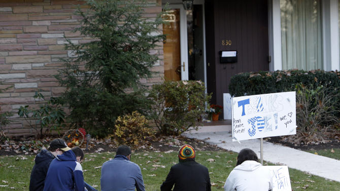 People gather outside the home of former Penn State football coach Joe Paterno after their 17-14 loss to Nebraska in an NCAA college football game, Saturday, Nov. 12, 2011 in State College, Pa. (AP Photo/Alex Brandon)