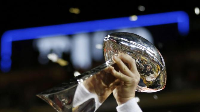 Denver Broncos' quarterback Peyton Manning holds the Vince Lombardi Trophy after the Broncos defeated the Carolina Panthers in the NFL's Super Bowl 50 football game in Santa Clara
