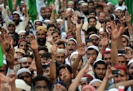 Pakistani Sunni Muslim protesters shout anti-US slogans during a rally against an anti-Islam movie in Karachi. Thousands of people rallied across Pakistan on Sunday to denounce an anti-Islam film with protestors burning US flags and effigies of President Barack Obama, and calling to sever ties with Washington