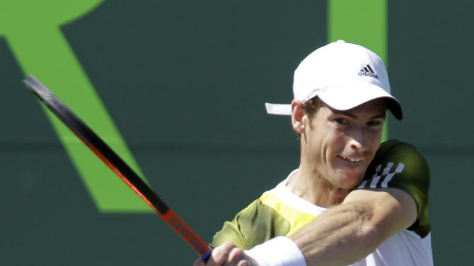 Andy Murray, of Great Britain, returns to Marin Cilic, of Croatia, during the quarterfinals of the Sony Open tennis tournament in Key Biscayne, Fla., Thursday, March 28, 2013. (AP Photo/Alan Diaz)