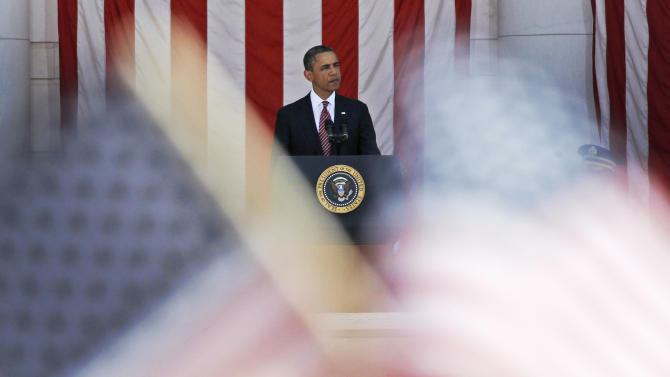 President Barack Obama speaks at the Memorial Day Observance at the Memorial Amphitheater at Arlington National Cemetery, Monday, May 28, 2012, in Arlington, Va. (AP Photo/Charles Dharapak)