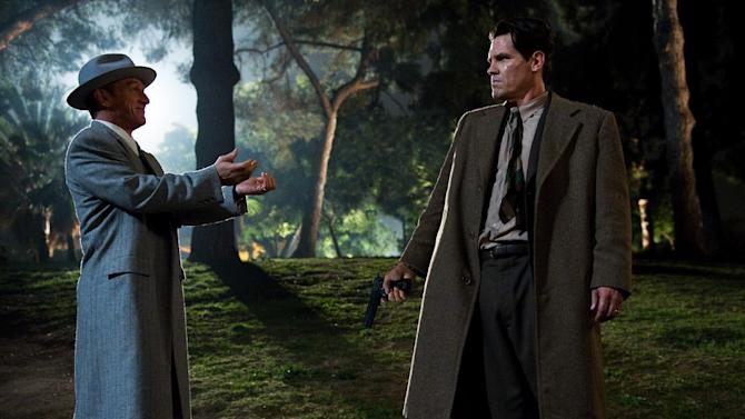 "FILE - This publicity film image released by Warner Bros. Pictures shows Sean Penn, left, as Mickey Cohen and Josh Brolin, as Sgt. John O'Mara in the film, ""Gangster Squad."" ""This isn't a movie promoting violence,"" said ""Gangster Squad"" producer Dennis Lin. ""It's a movie about unsung heroes.  (AP Photo/Warner Bros. Pictures, Wilson Webb, File)"