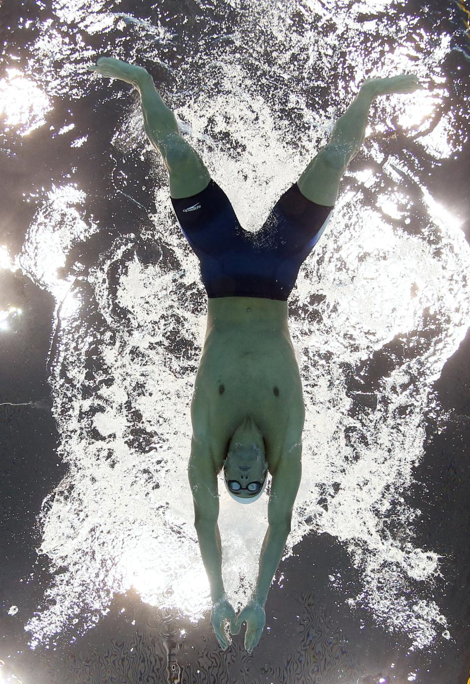 USA's Michael Phelps competes in a heat of the men's 400-meter individual medley at the Aquatics Centre in the Olympic Park during the 2012 Summer Olympics in London, Saturday, July 28, 2012. (AP Photo/David J. Phillip)