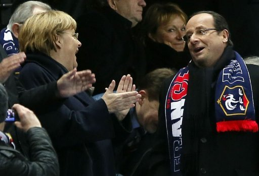 German Chancellor Angela Merkel and France's President Francois Hollande at the France-Germany match on February 6, 2013