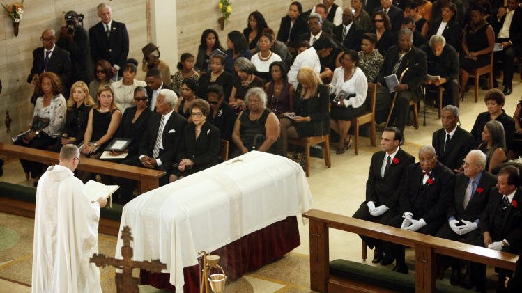 Mourners attend the funeral service for Mervyn Dymally Wednesday Oct. 17, 2012 in Culver City, Calif. Gov. Jerry Brown and dozens of other prominent officials attended the funeral of the trail-blazing leader, who in a four-decade career served in every corner of California government and eventually became the state's highest-ranking black politician. (AP Photo/Nick Ut)