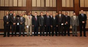 Members of the new Libyan government pose for a group photo in Tripoli