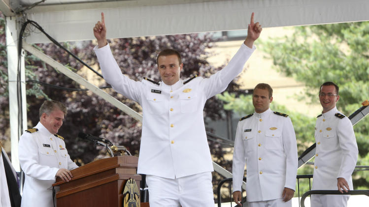 New graduate Matthew Bullard reacts as his name is called during commencement ceremonies at the United States Merchant Marine Academy in Kings Point, N.Y., Monday, June 18, 2012.   (AP Photo/Seth Wenig)