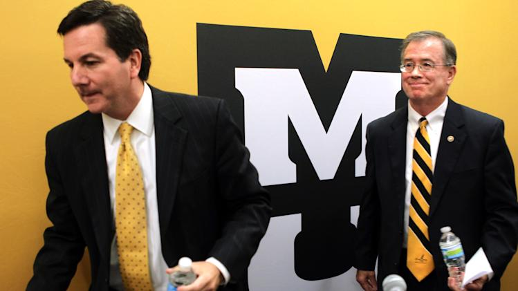 University of Missouri Interim President Steve Owens, left, and Chancellor Brady Deaton leave a news conference following a meeting of the Board of Curators, Tuesday, Oct. 4, 2011, in St. Louis. Curators voted Tuesday to consider leaving the Big 12 instead of committing to the troubled league for the long term. (AP Photo/St. Louis Post-Dispatch, Robert Cohen)  EDWARDSVILLE INTELLIGENCER OUT; THE ALTON TELEGRAPH OUT