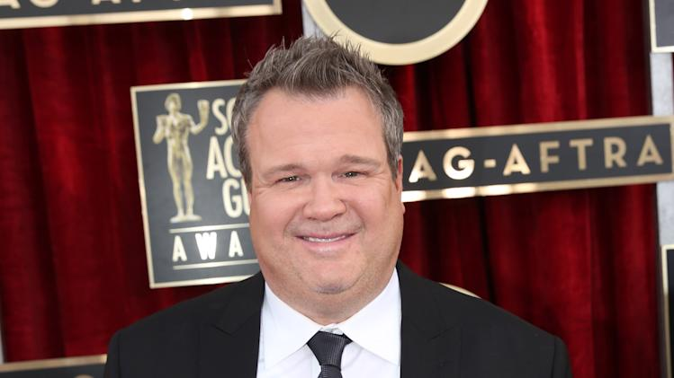 FILE - This Jan. 18, 2014 file photo shows actor Eric Stonestreet arrives at the 20th annual Screen Actors Guild Awards in Los Angeles. The two-time Emmy winner plays Cameron Tucker on the hit ABC series. On the show's season finale, he married his partner, Mitchell, in the landmark episode. Commemorating same sex marriage. (Photo by Matt Sayles/Invision/AP, File)