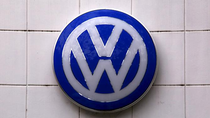 A Volkswagen logo hangs above a service center for the German automaker located in the Sydney suburb of Artarmon, Australia