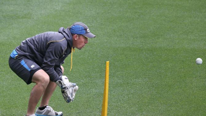 New Zealand's Luke Ronchi practices wicketkeeping during training for the Cricket World Cup final at the Melbourne Cricket Ground in Melbourne, Australia, Saturday, March 28, 2015. New Zealand will play Australia in the final Sunday. (AP Photo/Rick Rycroft)