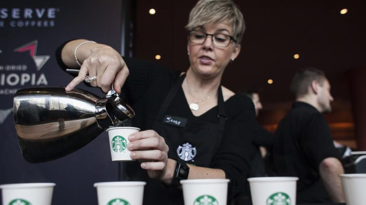 File photo of Sandy Roberts pouring samples of Starbucks Reserve Sun Dried Ethiopia Yirgacheffe coffee during the company's annual shareholders meeting in Seattle
