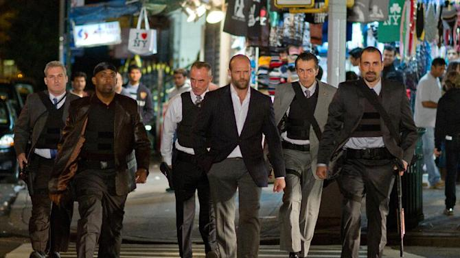 """In this film image released by Lionsgate, from left, James Colby, portraying Detective Mears, Barry Bradford, portraying Detective Benoit, Robert John Burke, portraying Captain Wolf, Jason Statham, portraying Luke Wright, Matt O'Toole, portraying Detective Lasky and Jay Giannone, portraying Detective Kolfax, are shown in a scene from """"Safe."""" (AP Photo/Lionsgate, John Baer)"""