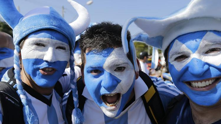 Argentinian fans cher reacting to the photographer as they arrive to attend the group F World Cup soccer match between Argentina and Iran at the Mineirao Stadium in Belo Horizonte, Brazil, Saturday, June 21, 2014. (AP Photo/Sergei Grits)