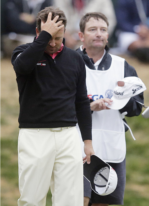 Graeme McDowell, of Northern Ireland, reacts as he walks off the 18th hole during the fourth round of the U.S. Open Championship golf tournament Sunday, June 17, 2012, at The Olympic Club in San Franc