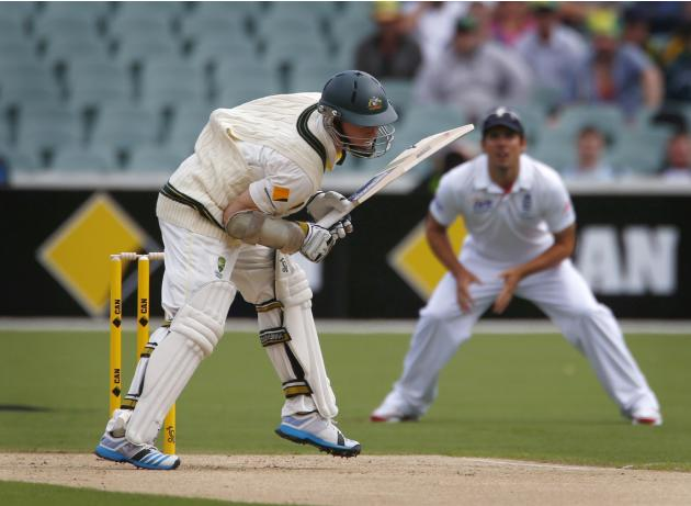 Ball catches inside the vest of Australia's Rogers during the first day's play of the second Ashes test against England in Adelaide