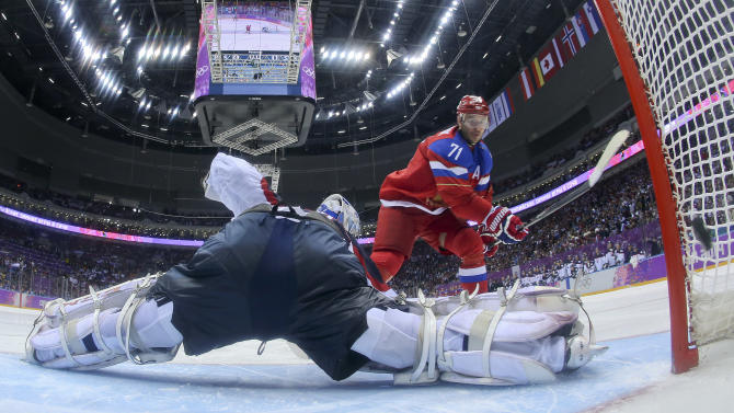Russia forward Ilya Kovalchuk flips the puck past Slovakia goaltender Jan Laco to score in a shootout during overtime of a men's ice hockey game at the 2014 Winter Olympics, Sunday Feb. 16, 2014, in Sochi, Russia. The shot gave Russia a 1-0 win. (AP Photo/Bruce Bennett, Pool)