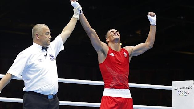 Britain's Anthony Ogogo reacts after defeating Dominican Republic's Junior Castillo Martinez in the Men's Middle (75kg) Round of 32 Bout 1