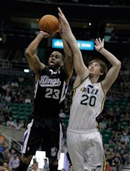 Sacramento Kings guard Marcus Thornton (23) shoots while Utah Jazz forward Gordon Hayward (20) defends during the first half of their NBA basketball game in Salt Lake City, Friday, March 30, 2012. (AP Photo/Steve C. Wilson)