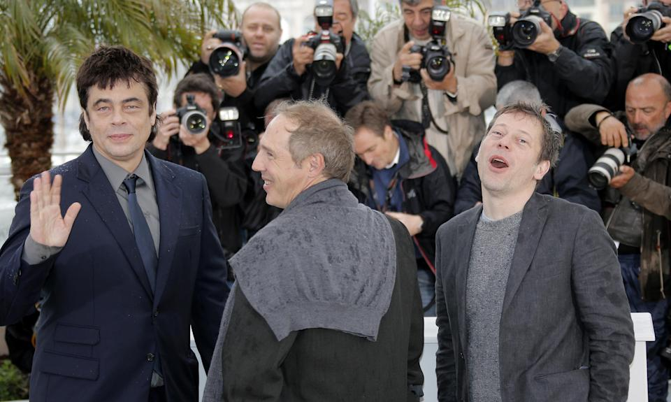 From left, actor Benicio Del Toro, director Arnaud Desplechin and actor Mathieu Amalric pose for photographers during a photo call for the film Jimmy P. Psychotheraphy of a Plains Indian at the 66th international film festival, in Cannes, southern France, Saturday, May 18, 2013. (AP Photo/Lionel Cironneau)