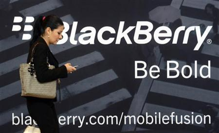 A woman uses her mobile phone at the Blackberry World Event in Orlando
