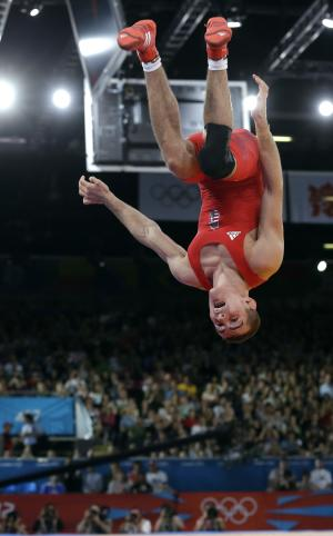 Hungary's Peter Modos celebrates after his victory over Denmark's Haakan Erik Nyblom in a 55-kg bronze medal match in Greco-Roman wrestling competition at the 2012 Summer Olympics, Sunday, Aug. 5, 2012, in London. (AP Photo/Paul Sancya)