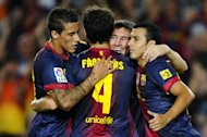 BARCELONA, SPAIN - AUGUST 19:  Lionel Messi of FC Barcelona (2nd R) celebrates with his tem-mates after scoring their second goal during the La Liga match between FC Barcelona and Real Sociedad de Futbol at Camp Nou on August 19, 2012 in Barcelona, Spain.  (Photo by David Ramos/Getty Images)
