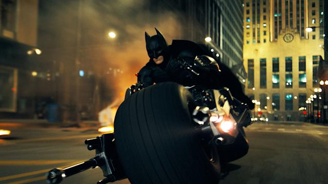 "FILE - In this undated file image released by Warner Bros., Christian Bale is shown as Batman in a scene from ""The Dark Knight"" from 2008. Hollywood studio Legendary Entertainment which produced ""The Dark Knight"" signed an agreement with the state-owned China Film Group on Thursday, May 30, 2013 in Beijing. (AP Photo/Warner Bros., File)"