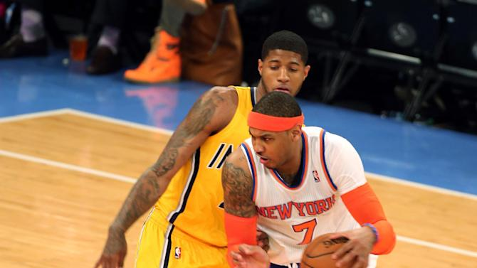 New York Knicks forward Carmelo Anthony (7) drives around Indiana Pacers forward Paul George in the first half of Game 2 of their NBA basketball playoff series in the Eastern Conference semifinals at Madison Square Garden in New York, Tuesday, May 7, 2013. (AP Photo/Peter Morgan)