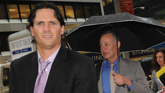 Winnipeg Jets' Ron Hainsey, left, and Steve Fehr, players union special counsel, arrive at NHL headquarters in New York, Friday, Sept. 28, 2012. With the clock ticking down to the start of the season, the NHL and its locked-out players are talking again. (AP Photo/ Louis Lanzano)