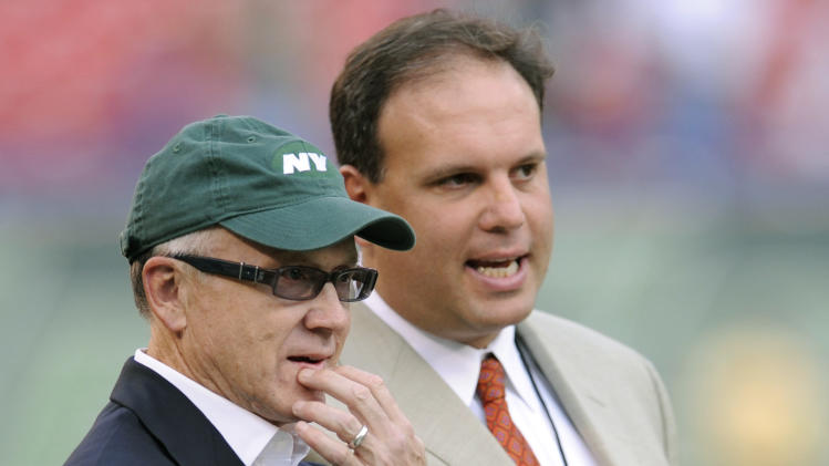 "FILE - In this Sept. 3, 2009 file photo, New York Jets Chairman and CEO Woody Johnson, left, and General Manager Mike Tannenbaum talk prior to an NFL preseason football game against the Philadelphia Eagles at Giants Stadium in East Rutherford, N.J. The New York Jets have fired Tannenbaum and say coach Rex Ryan will be back next season. Johnson said in a statement Monday, Dec. 31, 2012, that ""like all Jets fans, I am disappointed with this year's results."" (AP Photo/Bill Kostroun, File)"
