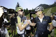 Keegan Swirlbul and Lance Armstrong (R) finish the Power of Four Mountain Bike Race on Aspen Mountain in Aspen, Colorado. Armstrong, branded a drug cheat and banned from cycling by the US Anti-Doping Agency, was back on a bike in Colorado and loving every minute of it