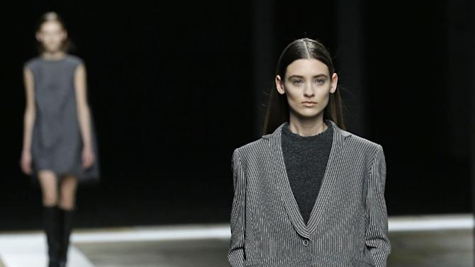 Models walk the runway during the Theyskens Theory Fall 2013 show at Fashion Week in New York, Monday, Feb. 11, 2013.  (AP Photo/Kathy Willens)
