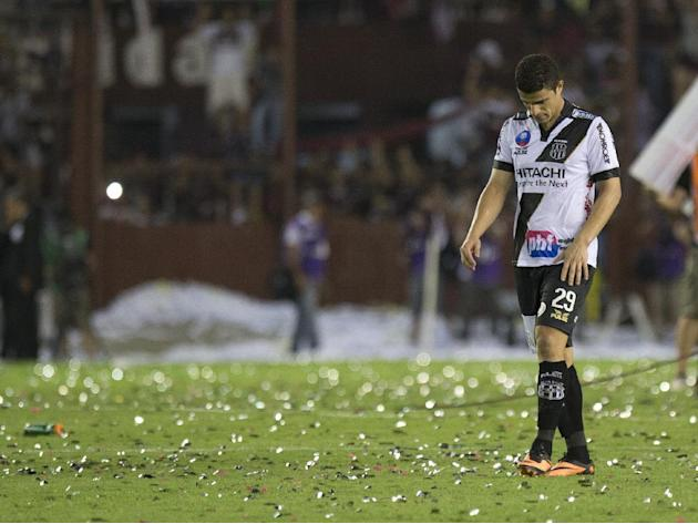 Brazil's Ponte Preta's Leonardo leave the field after loosing the Copa Sudamericana final soccer match against Argentina's Lanus in Buenos Aires, Argentina, Wednesday, Dec. 11, 2013