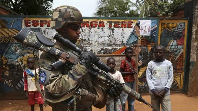 A French soldier from the newly deployed EUFOR-RCA European Union military operation in the Central African Republic, carries his weapon as he patrols along a street in Bangui
