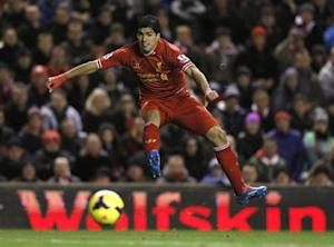 Liverpool's Suarez takes a shot on goal against Norwich City during their English Premier League soccer match at Anfield in Liverpool