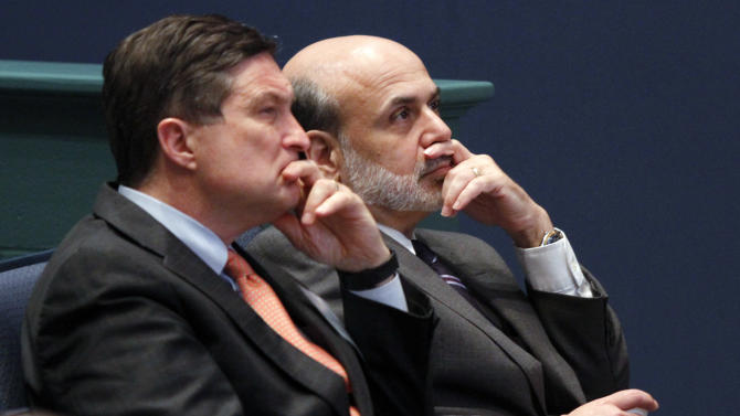 """FILE - In this June 9, 2010, file photo, Federal Reserve Chairman, Ben Bernanke, right, listens with president of the Federal Reserve of Richmond, Jeffrey Lacker, left, at J. Sergeant Reynolds Community College in Richmond, Va.  With an eye on the """"fiscal cliff,"""" the Federal Reserve is expected to announce a new bond-buying plan to support the U.S. economy on Tuesday, Dec. 11, 2012. Lacker has said he thinks the job market is being slowed by factors beyond the Fed's control and he says further bond purchases risk worsening future inflation. (AP Photo/Steve Helber, File)"""