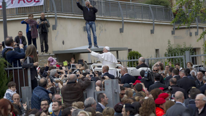 Pope Francis leaves after celebrate mass in the St. Elizabeth and Zacharia parish church, in Rome, Sunday, May 26, 2013. (AP Photo/Andrew Medichini)