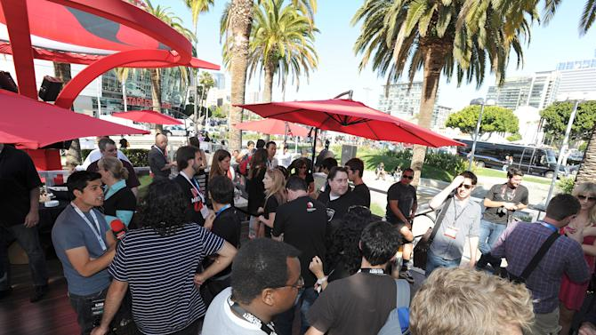 """COMMERCIAL IMAGE - In this image provided by Qualcomm - People visit during the Snapdragon Gaming World Record Challenge at E3 in a the Guinness Book of World Records for """"Longest video games marathon on a tablet"""" on Wednesday June 6, 2012, in Los Angeles. (Photo by Eric Reed/Invision for Qualcomm/AP Images)"""