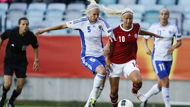 Finland's Tiina Saario (L) vies with Denmark's Pernille Harder during the UEFA Women's EURO 2013 group A soccer match between Denmark and Finland, at Gamla Ullevi stadium in Gothenburg,
