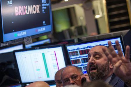 Specialist trader Giacchi shouts out a price for Brixmor Property Group Inc. during the company's IPO on the floor of the New York Stock Exchange, in New York