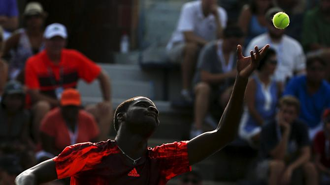 Tiafoe of the U.S. serves to Troicki of Serbia in their first round match at the U.S. Open Championships tennis tournament in New York