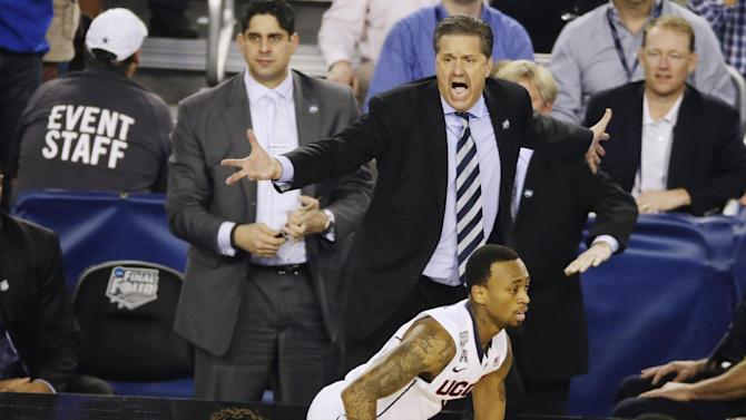 Kentucky head coach John Calipari calls to his team against Connecticut during the second half of the NCAA Final Four tournament college basketball championship game Monday, April 7, 2014, in Arlington, Texas