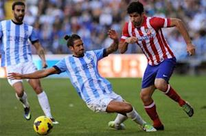Malaga 0-1 Atletico Madrid: Koke sends Rojiblancos three points clear of Barcelona