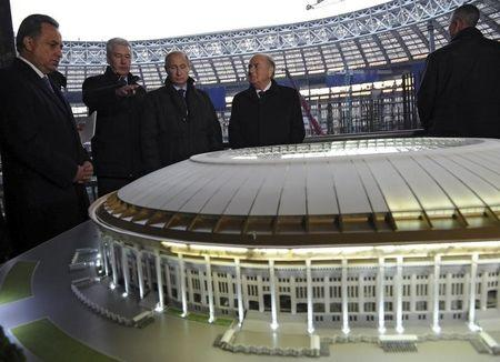 Russia's Sports Minister Mutko, President Putin and FIFA President Blatter listens to Moscow's Mayor Sobyanin at the Luzhniki Stadium in Moscow