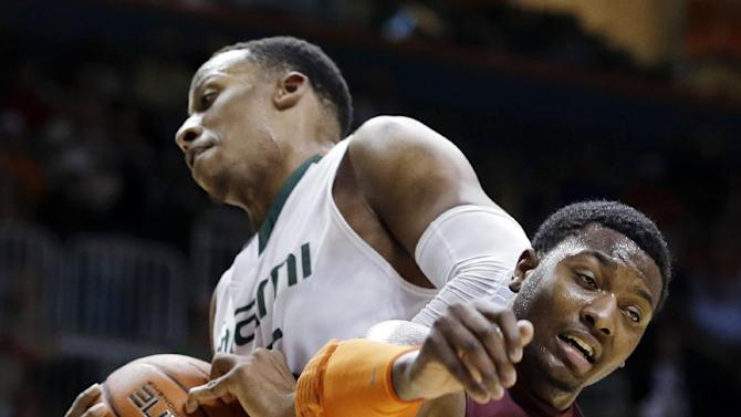 Virginia Tech's C.J. Barksdale (42) loses a rebound to Miami's Kenny Kadji (35) during the first half of an NCAA college basketball game in Coral Gables, Fla., Wednesday, Feb. 27, 2013. (AP Photo/J Pat Carter)