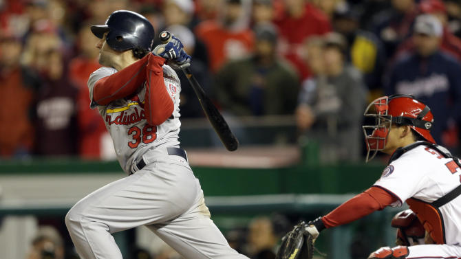 St. Louis Cardinals' Pete Kozma singles in the ninth inning of Game 5 of the National League division baseball series against the Washington Nationals on Saturday, Oct 13, 2012, in Washington. David Freese and Daniel Descalso scored on the play. (AP Photo/Pablo Martinez Monsivais)