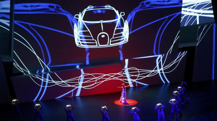 Actors performs during the Bugatti presentation at the Volkswagen group night at the Frankfurt motor show