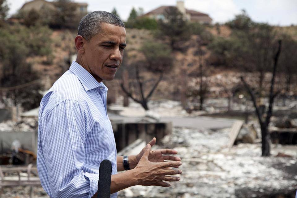 President Barack Obama talks with media as he tours the Mountain Shadow neighborhood devastated by raging wildfires, Friday, June 29, 2012, in Colorado Springs, Colo. (AP Photo/Carolyn Kaster)